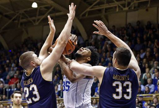 Duke's Marvin Bagley III (35) tries to shoot while Notre Dame's Martinas Geben (23) and John Mooney (33) defend during the first half of an NCAA college basketball game in Durham, N.C., Monday, Jan. 29, 2018.