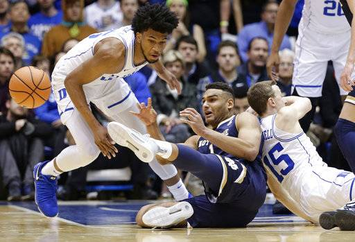 Duke's Marvin Bagley III, left, and Alex O'Connell (15) chase the ball with Notre Dame's Austin Torres during the first half of an NCAA college basketball game in Durham, N.C., Monday, Jan. 29, 2018.