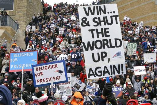 New England Patriots fans hold placards and cheer during an NFL football Super Bowl send-off rally for the team, Monday, Jan. 29, 2018, in Foxborough, Mass. The Patriots are to play the Philadelphia Eagles in Super Bowl 52, Sunday, Feb. 4, in Minneapolis.