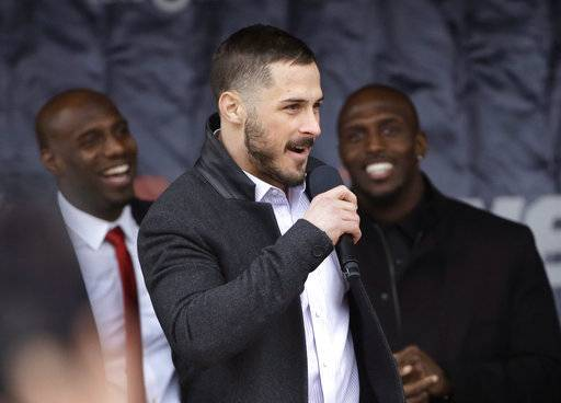 New England Patriots wide receiver Danny Amendola, center, addresses the crowd as strong safety Duron Harmon, left, and free safety Devin McCourty, right, smile during an NFL football Super Bowl send-off rally, Monday, Jan. 29, 2018, in Foxborough, Mass. The Patriots are to play the Philadelphia Eagles in Super Bowl 52, Sunday, Feb. 4, in Minneapolis.