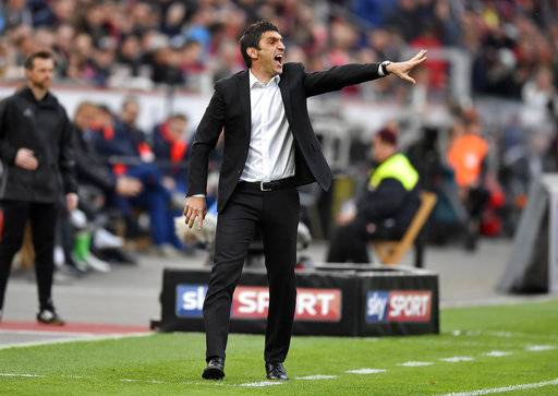 FILE - In this April 15, 2017 file photo then Leverkusen's head coach Tayfun Korkut gestures during the German Bundesliga soccer match between Bayer Leverkusen and Bayern Munich in Leverkusen, Germany. Stuttgart has hired Tayfun Korkut as coach to replace Hannes Wolf, the coach who led the side to Bundesliga promotion last season. The club says the 43-year-old Korkut, a Stuttgart native, is getting a contract to summer 2019.