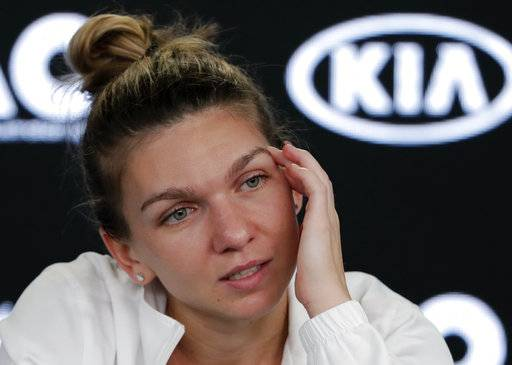 Romania's Simona Halep answers questions at a press conference following her loss to Denmark's Caroline Wozniacki in the women's singles final at the Australian Open tennis championships in Melbourne, Australia, Saturday, Jan. 27, 2018.