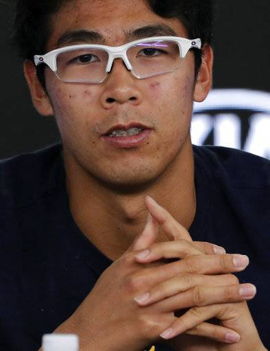 South Korea's Hyeon Chung answers questions at a press conference following his retirement from his semifinal against Switzerland's Roger Federer at the Australian Open tennis championships in Melbourne, Australia, Friday, Jan. 26, 2018.