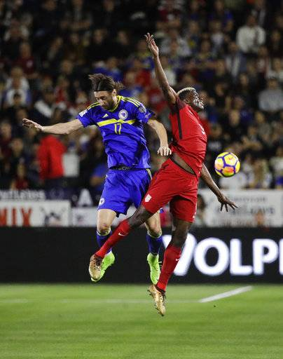 United States midfielder Gyasi Zardes, right, and Bosnia and Herzegovina forward Mersudin Ahmetovic miss the header during the first half of an international friendly soccer match on Sunday, Jan. 28, 2018, in Carson, Calif.