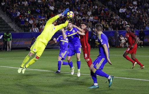 Bosnia and Herzegovina goalkeeper Ibrahim Sehic, left, makes a save during the first half of an international friendly soccer match against the United States on Sunday, Jan. 28, 2018, in Carson, Calif.