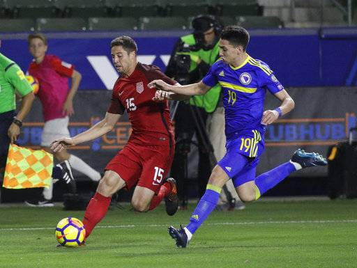 United States defender Matt Polster, left, controls the ball under pressure by Bosnia and Herzegovina forward Luka Menalo during the first half of an international friendly soccer match on Sunday, Jan. 28, 2018, in Carson, Calif.