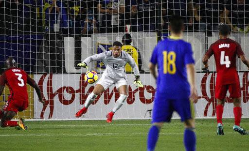 United States goalkeeper Zack Steffen (12) looks to make a save during the second half of an international friendly soccer match against Bosnia and Herzegovina Sunday, Jan. 28, 2018, in Carson, Calif. The game ended in a 0-0 draw.