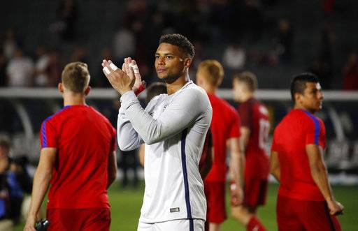 United States goalkeeper Zack Steffen, center, and teammates acknowledge the fans after the team's international friendly soccer match against Bosnia and Herzegovina, Sunday, Jan. 28, 2018, in Carson, Calif. The game ended in a 0-0 draw.