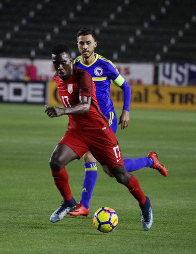 United States forward CJ Sapong, front, controls the ball against Bosnia and Herzegovina midfielder Haris Medunjanin during the first half of an international friendly soccer match on Sunday, Jan. 28, 2018, in Carson, Calif.