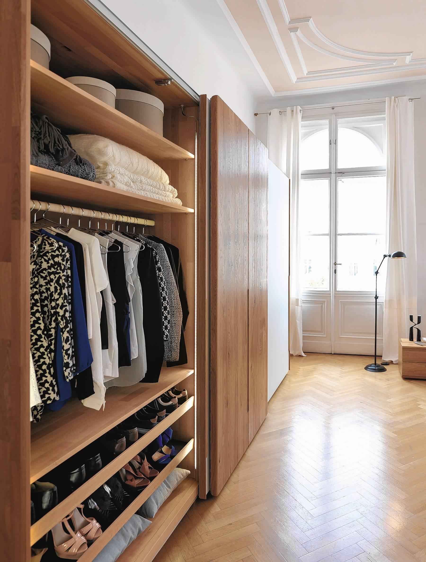 This manufactured wardrobe from Europe can be used as inspiration for your ownboarn door projects.