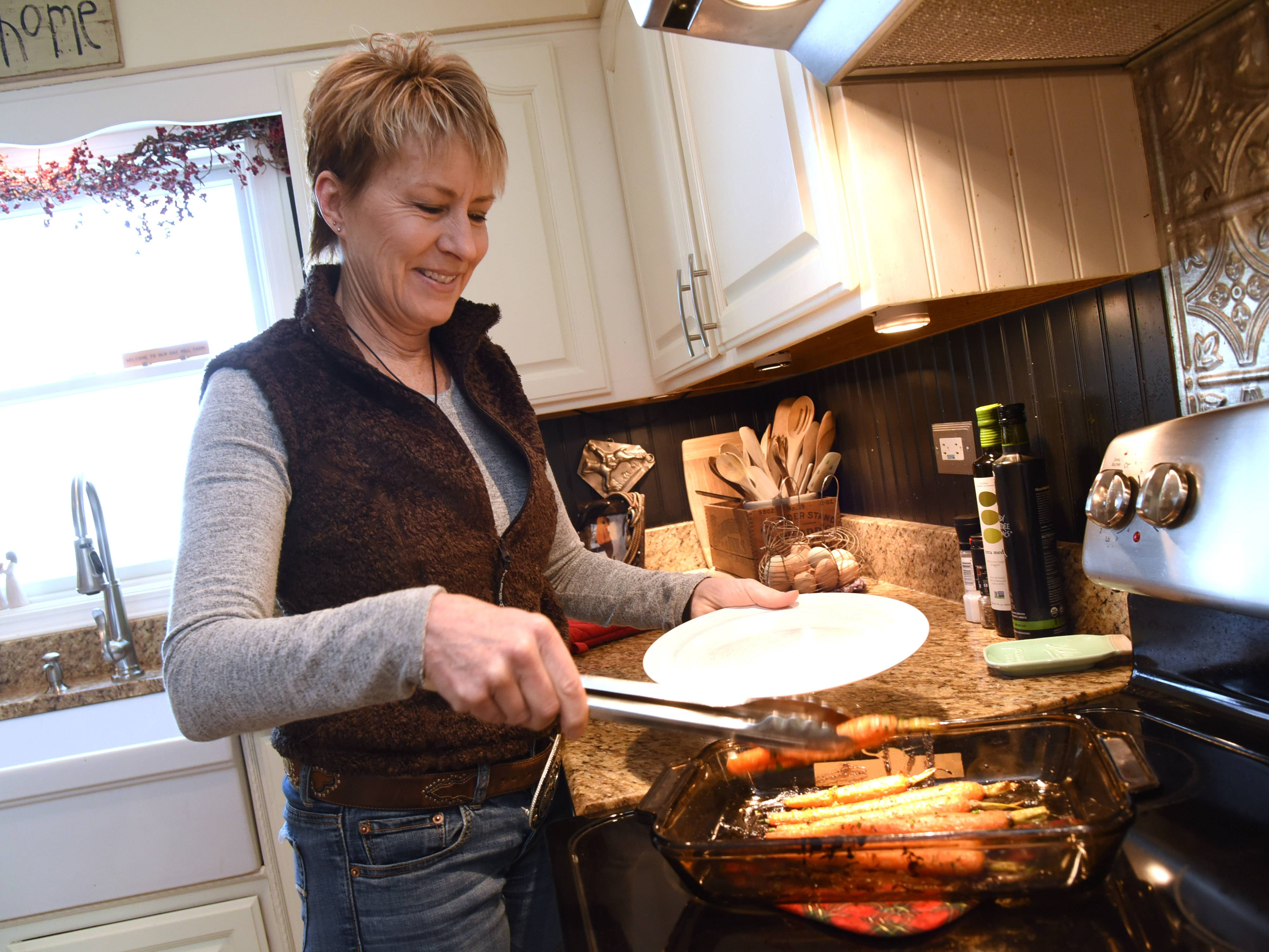 Paul Valade/pvalade@dailyherald.comNorth Barrington resident Pam Zeidman plates her Honey Thyme Roasted Carrots.