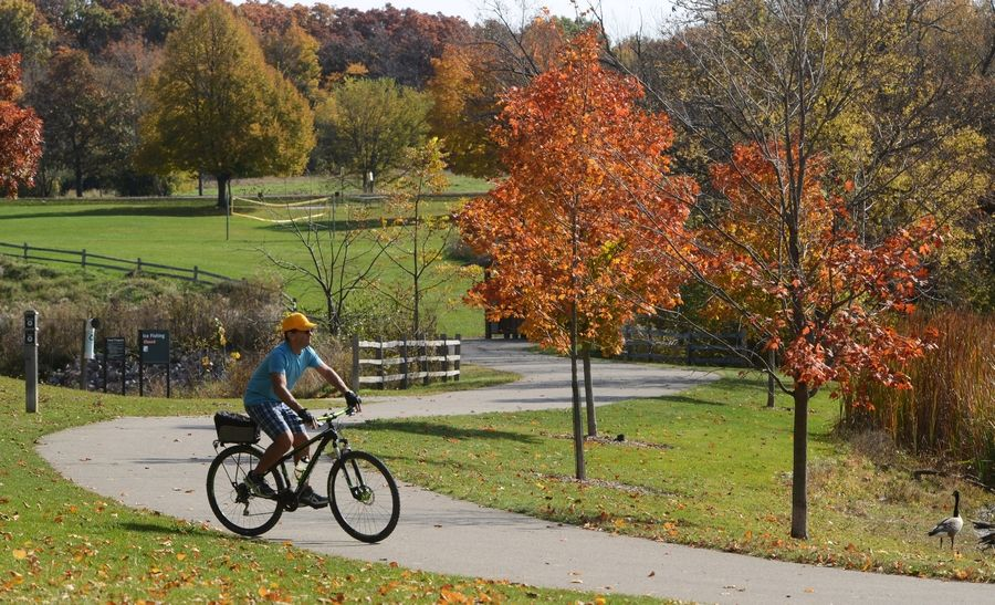 A bicyclist spins through Lakewood Forest Preserve near Wauconda. Master planning for the Lake County Forest Preserve District's largest preserve is underway.