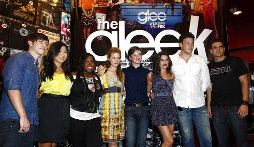 "FILE - In this Aug. 28, 2009 file photo, cast members, from left, Kevin McHale, Jenna Ushkowitz, Amber Riley, Dianna Agron, Chris Colfer, Lea Michele, Cory Monteith, and Mark Salling pose for photographers during The Gleek Tour for the television show ""Glee"" in Los Angeles.  Salling, one of the stars of the Fox musical comedy ""Glee,� died, Tuesday Jan. 30, 2018. He was 35. Salling's lawyer, Michael J. Proctor did not release the cause of death. Salling pleaded guilty in December to possession of child pornography."
