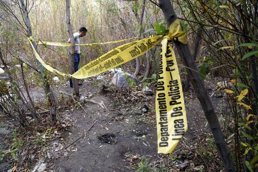 "A person stands near the spot where Mark Salling, who played Noah ""Puck"" Puckerman in the hit musical-comedy ""Glee,"" was found dead in a remote area of Big Tujunga Canyon in the Sunland-Tujunga area of Los Angeles, Tuesday, Jan. 30, 2018. Authorities say Salling died of an apparent suicide. He was 35."