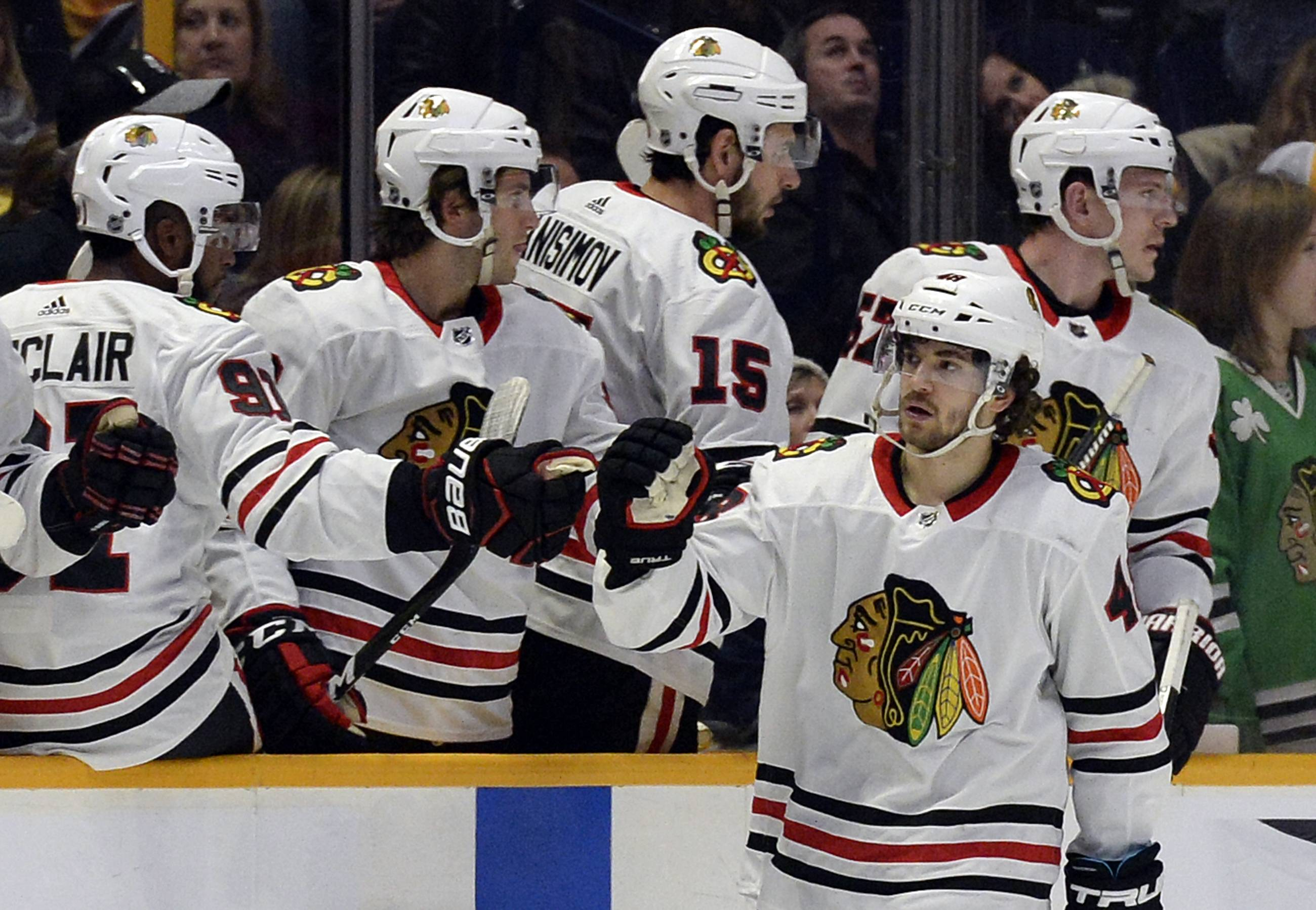 Chicago Blackhawks left wing Vinnie Hinostroza (48) is congratulated after scoring a goal against the Nashville Predators during the second period of an NHL hockey game Tuesday, Jan. 30, 2018, in Nashville, Tenn.