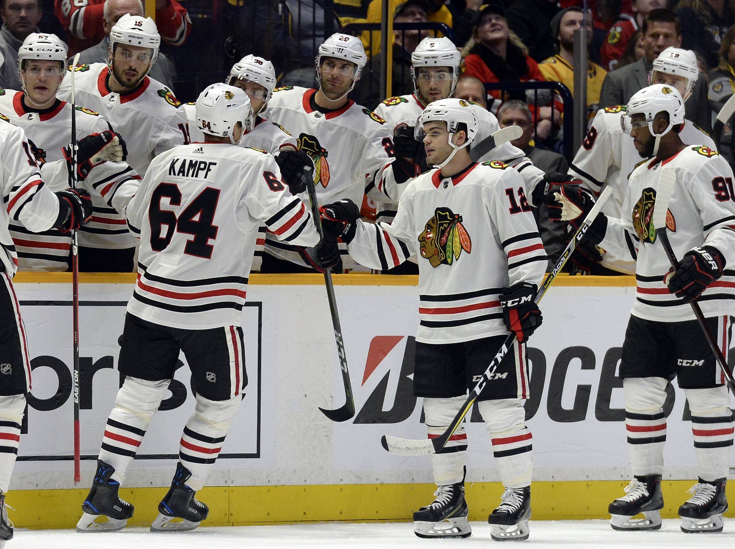 Chicago Blackhawks center David Kampf (64), of Czech Republic, is congratulated after scoring a goal against the Nashville Predators during the first period of an NHL hockey game Tuesday, Jan. 30, 2018, in Nashville, Tenn.