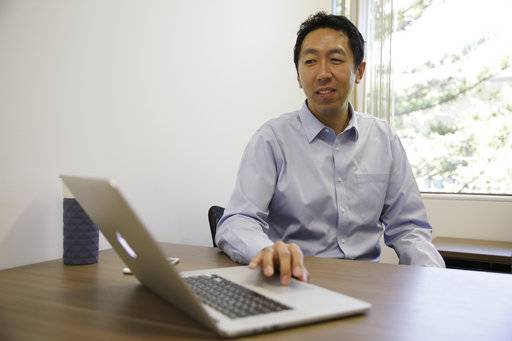 FILE - In this Friday, July 14, 2017, file photo, computer scientist Andrew Ng works at his office in Palo Alto, Calif. Ng, the cofounder of online education platform Coursera who's led AI teams at Google and Baidu, says he's launching a $175 million fund to invest in AI startups, backed by private equity firms NEA, Sequoia, Greylock Partners and Softbank.
