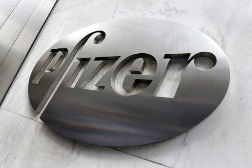 This Monday, Dec. 4, 2017, photo shows the Pfizer company logo at the company's headquarters in New York. Pfizer Inc. reports earnings Tuesday, Jan. 30, 2018.