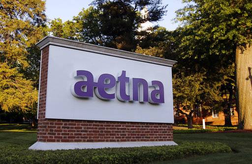 FILE - This Thursday, June 1, 2017, file photo shows a sign on the campus of the Aetna headquarters in Hartford, Conn. Aetna Inc. reports earnings Tuesday, Jan. 30, 2018.