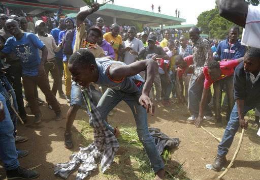 "A suspected thief is beaten by National Super Alliance (NASA) Kenya opposition supporters after he attempted to snatch a mobile phone from one of them as they gather for a mock inauguration for Raila Odinga, in Nairobi, Kenya. Tuesday, Jan. 30, 2018. Kenya's press is reporting that the government has switched off three TV stations after they aired live broadcasts of an event where the opposition is trying to ""swear in"" its leader Raila Odinga as an alternative president Tuesday."