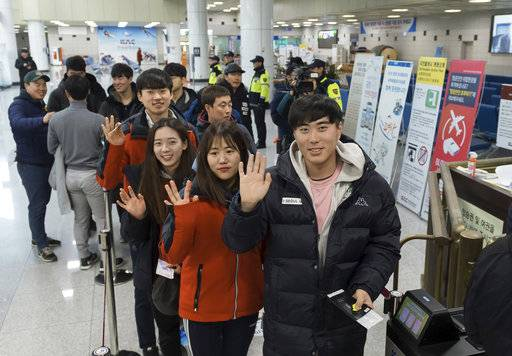South Korean skiers wave to the media before their departure to North Korea at Yangyang International Airport in Yangyang, South Korea, Wednesday, Jan. 31, 2018. Several South Korean skiers headed to North Korea on Wednesday to train with its athletes in a conciliatory gesture the countries planned to mark the Winter Olympics in the South. (Korea Pool/Yonhap via AP)