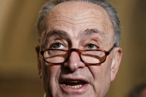 Senate Minority Leader Chuck Schumer, D-N.Y., speaks to reporters ahead of President Donald Trump's first State of the Union address, at the Capitol in Washington, Tuesday, Jan. 30, 2018. Schumer said Trump should thank his predecessor, Barack Obama, for the booming economy during the address.