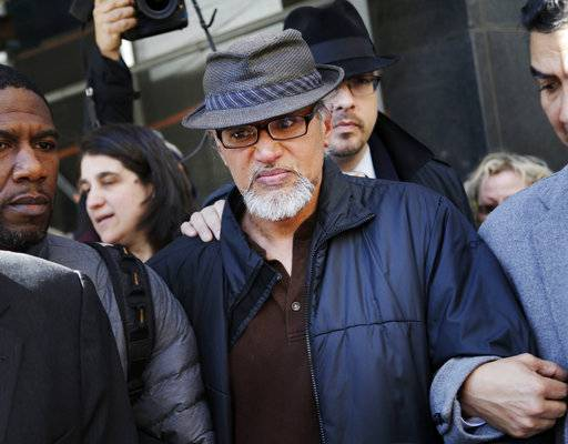 File-This March 9, 2017, file photo shows Ravi Ragbir, executive director of the New Sanctuary Coalition, being escorted by supporters after his annual check-in with Immigration and Customs Enforcement, in New York. U.S. Rep. Nydia Velazquez has invited the wife of detained immigrant rights activist Ravi Ragbir to President Donald Trump's State of the Union address. Ragbir was in federal custody Saturday, several weeks after he was arrested during a routine check-in with the Immigration and Customs Enforcement agency. On Saturday, Velazquez, a Democrat, joined Ragbir's wife, Amy Gottlieb, and other elected officials at a rally in front of the Manhattan office building that houses ICE.