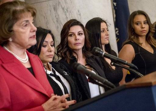 From left, Sen. Dianne Feinstein, D-Calif., accompanied by former U.S.A. gymnastics national team members and abuse survivors Jeanette Antolin, Jamie Dantzscher, Dominique Moceanu, and Mattie Larson, speaks at a news conference on legislation to prevent future abuse of young athletes, on Capitol Hill, Tuesday, Jan. 30, 2018, in Washington.