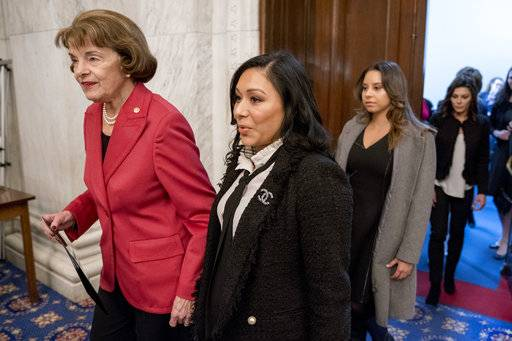 From left, Sen. Dianne Feinstein, D-Calif., and former U.S.A. gymnastics national team members and abuse survivors Jeanette Antolin, Mattie Larson, and Jamie Dantzscher, arrive for a news conference on legislation to prevent future abuse of young athletes on Capitol Hill, Tuesday, Jan. 30, 2018, in Washington.