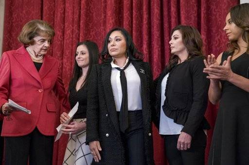 From left, Sen. Dianne Feinstein, D-Calif., and former U.S.A. gymnastics national team members and abuse survivors Dominique Moceanu, Jeanette Antolin, Jamie Dantzscher, and Mattie Larson, hold a news conference on legislation to prevent future abuse of young athletes, on Capitol Hill, Tuesday, Jan. 30, 2018, in Washington.