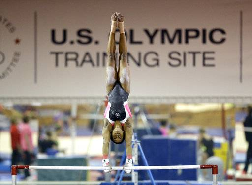 In this Sept, 12, 2015 photo, U.S. gymnast Gabby Douglas trains at the Karolyi Ranch near New Waverly, Texas. Texas Gov. Greg Abbott on Tuesday, Jan. 30, 2018, has ordered a criminal investigation into claims that former doctor Larry Nassar abused some of his victims at the Texas ranch that was the training ground for U.S. women's gymnastics .