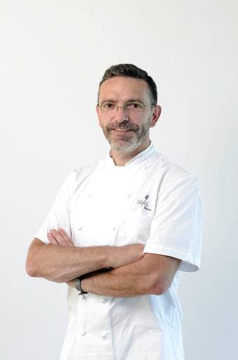 This undated picture provided by the PR agent of the Sebastien Bras restaurant, Le Suquet, in Laguiole, central France, shows French cook Sebastien Bras. In an unprecedented move, the Michelin guide allowed on Tuesday, Jan. 30, 2018 a three-star chef to withdraw his restaurant from its prestigious listings. Sebastien Bras had announced in September that he didn't want Le Suquet restaurant in southern France to figure in the guide anymore because of the huge pressure involved. (Jean-Louis Bellurget/Bras via AP)