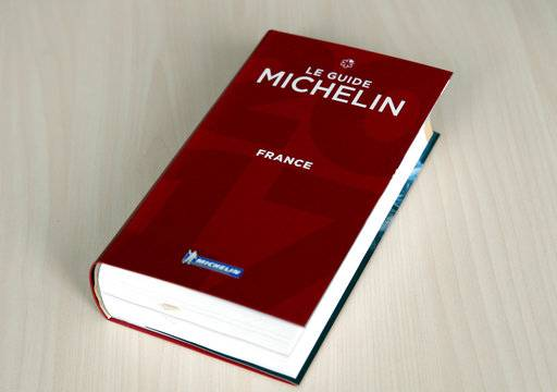 FILE - In this file photo dated Thursday, Feb.9, 2017, The Michelin Guide 2017 is pictured in Paris, France. The Michelin guide said in a statement Tuesday Jan. 30, 2018, it has allowed chef Sebastien Bras to withdraw his Le Suquet three-star restaurant in southern France, from its 2018 edition because of the huge pressure involved.