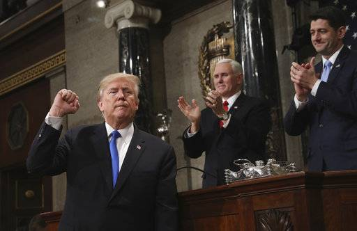 President Donald Trump gestures as he finishes his first State of the Union address in the House chamber of the U.S. Capitol to a joint session of Congress Tuesday, Jan. 30, 2018 in Washington, as Vice President Mike Pence and House Speaker Paul Ryan applaud. (Win McNamee/Pool via AP)
