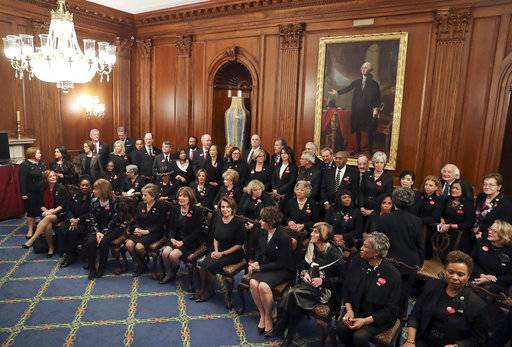 House Minority Leader Nancy Pelosi of Calif., center seated, with other House members wearing black in support the #metoo and #timesup movement, pose for a group photo ahead of tonight's State of the Union address on Capitol Hill in Washington, Tuesday, Jan. 30, 2018.