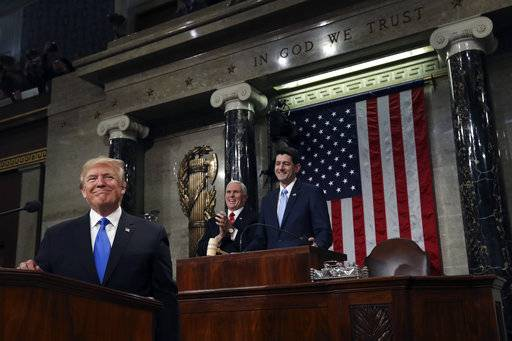 President Donald Trump pauses as delivers his first State of the Union address in the House chamber of the U.S. Capitol to a joint session of Congress Tuesday, Jan. 30, 2018 in Washington. (Win McNamee/Pool via AP)