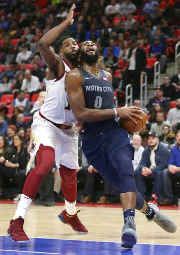 Detroit Pistons center Andre Drummond (0) goes to the basket past Cleveland Cavaliers center Tristan Thompson, left, during the first half of an NBA basketball game Tuesday, Jan. 30, 2018, in Detroit.