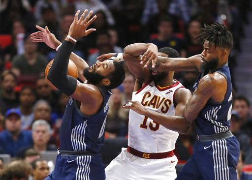 Detroit Pistons center Andre Drummond, left, loses control of the ball after Pistons forward Reggie Bullock, right, knocked it away from Cleveland Cavaliers center Tristan Thompson (13) during the first half of an NBA basketball game Tuesday, Jan. 30, 2018, in Detroit.