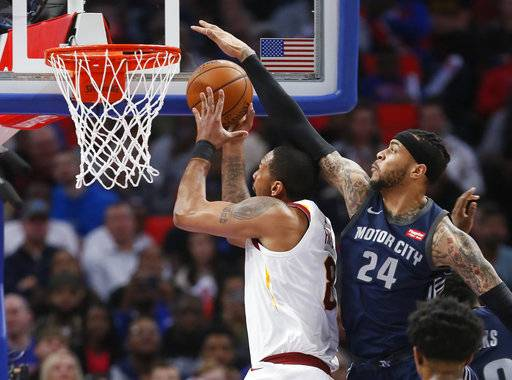 Detroit Pistons forward Eric Moreland (24) defends against a shot by Cleveland Cavaliers forward Channing Frye (8) during the first half of an NBA basketball game Tuesday, Jan. 30, 2018, in Detroit.