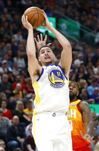 Utah Jazz forward Royce O'Neale, rear, defends against Golden State Warriors guard Klay Thompson (11) in the first half during an NBA basketball game Tuesday, Jan. 30, 2018, in Salt Lake City.