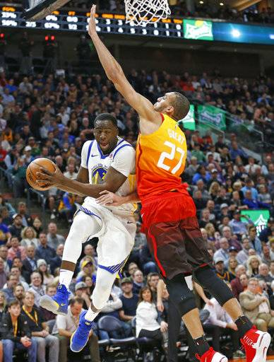 Utah Jazz center Rudy Gobert (27) defends against Golden State Warriors forward Draymond Green, left, in the first half during an NBA basketball game Tuesday, Jan. 30, 2018, in Salt Lake City.