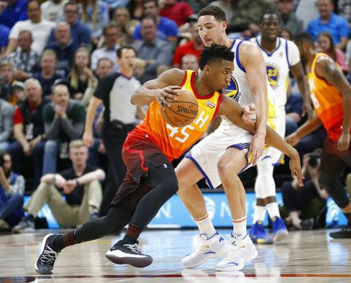 Utah Jazz guard Donovan Mitchell (45) drives around Golden State Warriors guard Klay Thompson, right, in the first half during an NBA basketball game Tuesday, Jan. 30, 2018, in Salt Lake City.