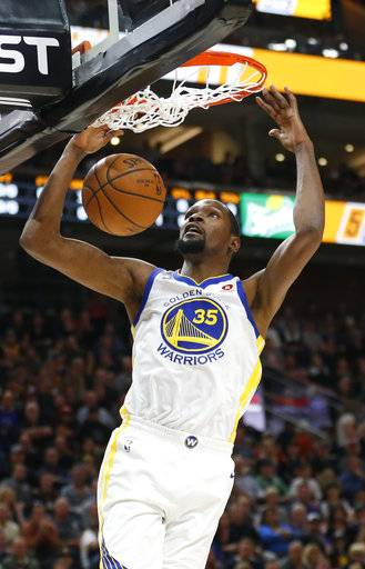 Golden State Warriors forward Kevin Durant (35) dunks the ball against the Utah Jazz in the first half during an NBA basketball game Tuesday, Jan. 30, 2018, in Salt Lake City.