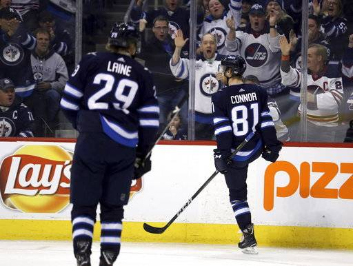 Winnipeg Jets' Kyle Connor (81) celebrates after scoring against the Tampa Bay Lightning during the second period of an NHL hockey game, Tuesday, Jan. 30, 2018 in Winnipeg, Manitoba. (Trevor Hagan/The Canadian Press via AP)