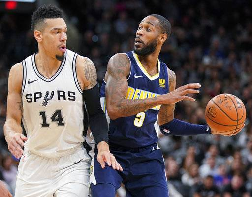 Denver Nuggets' Will Barton (5) drives against San Antonio Spurs' Danny Green during the first half of an NBA basketball game Tuesday, Jan. 30, 2018, in San Antonio.