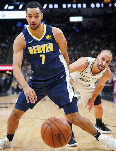 Denver Nuggets' Trey Lyles (7) and San Antonio Spurs' Manu Ginobili chase the ball during the first half of an NBA basketball game Tuesday, Jan. 30, 2018, in San Antonio.