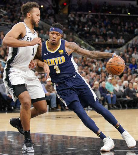 Denver Nuggets' Torrey Craig (3) drives against San Antonio Spurs' Kyle Anderson during the first half of an NBA basketball game Tuesday, Jan. 30, 2018, in San Antonio.