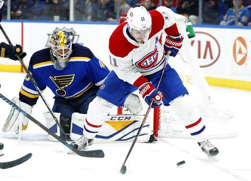 Montreal Canadiens' Brendan Gallagher (11) controls the puck as St. Louis Blues goaltender Carter Hutton defends during the first period of an NHL hockey game Tuesday, Jan. 30, 2018, in St. Louis.