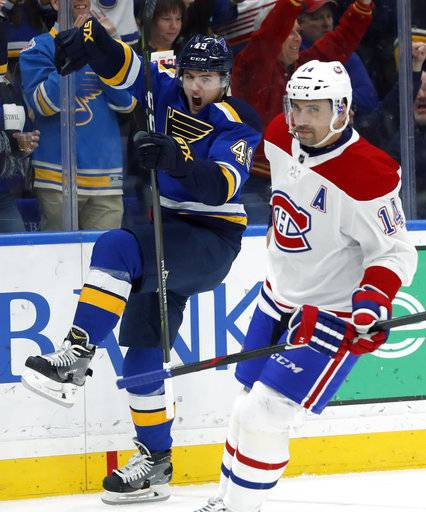 St. Louis Blues' Ivan Barbashev, left, celebrates after scoring as Montreal Canadiens' Tomas Plekanec, of the Czech Republic, skates past during the second period of an NHL hockey game Tuesday, Jan. 30, 2018, in St. Louis.