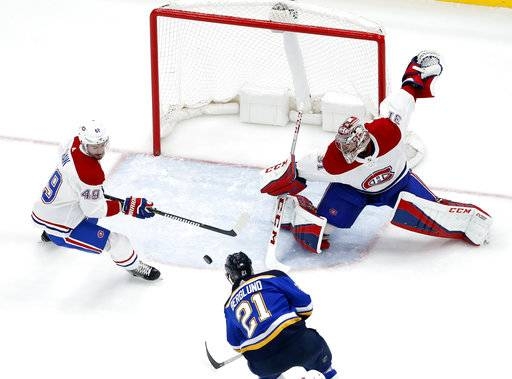St. Louis Blues' Patrik Berglund (21), of Sweden, scores past Montreal Canadiens goaltender Carey Price (31) and Logan Shaw (49) during the third period of an NHL hockey game Tuesday, Jan. 30, 2018, in St. Louis. The Blues won 3-1.